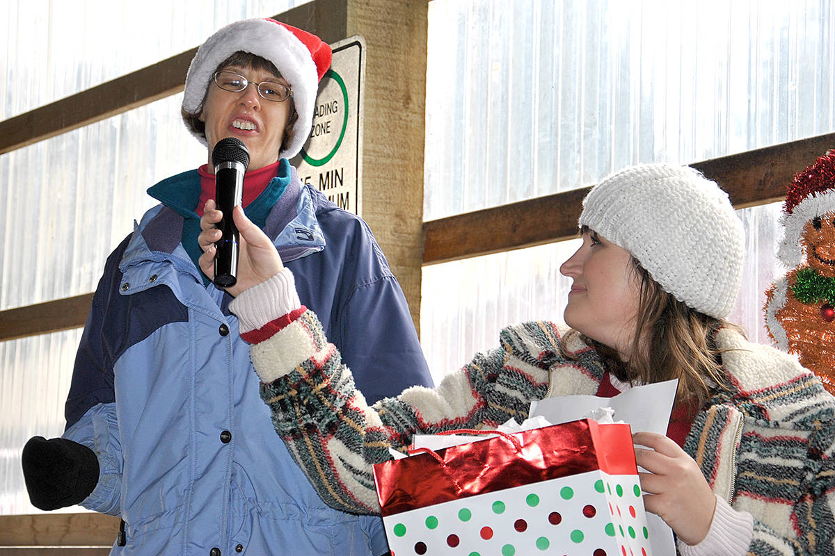 Abbotsford's Kimberly Bloom has been a client with VTEA for 31 years. Keeping up her tradition, she sang a few Christmas carols for the open house crowd Dec. 15, bringing some to tears. (Roxanne Hooper/Langley Advance Times)