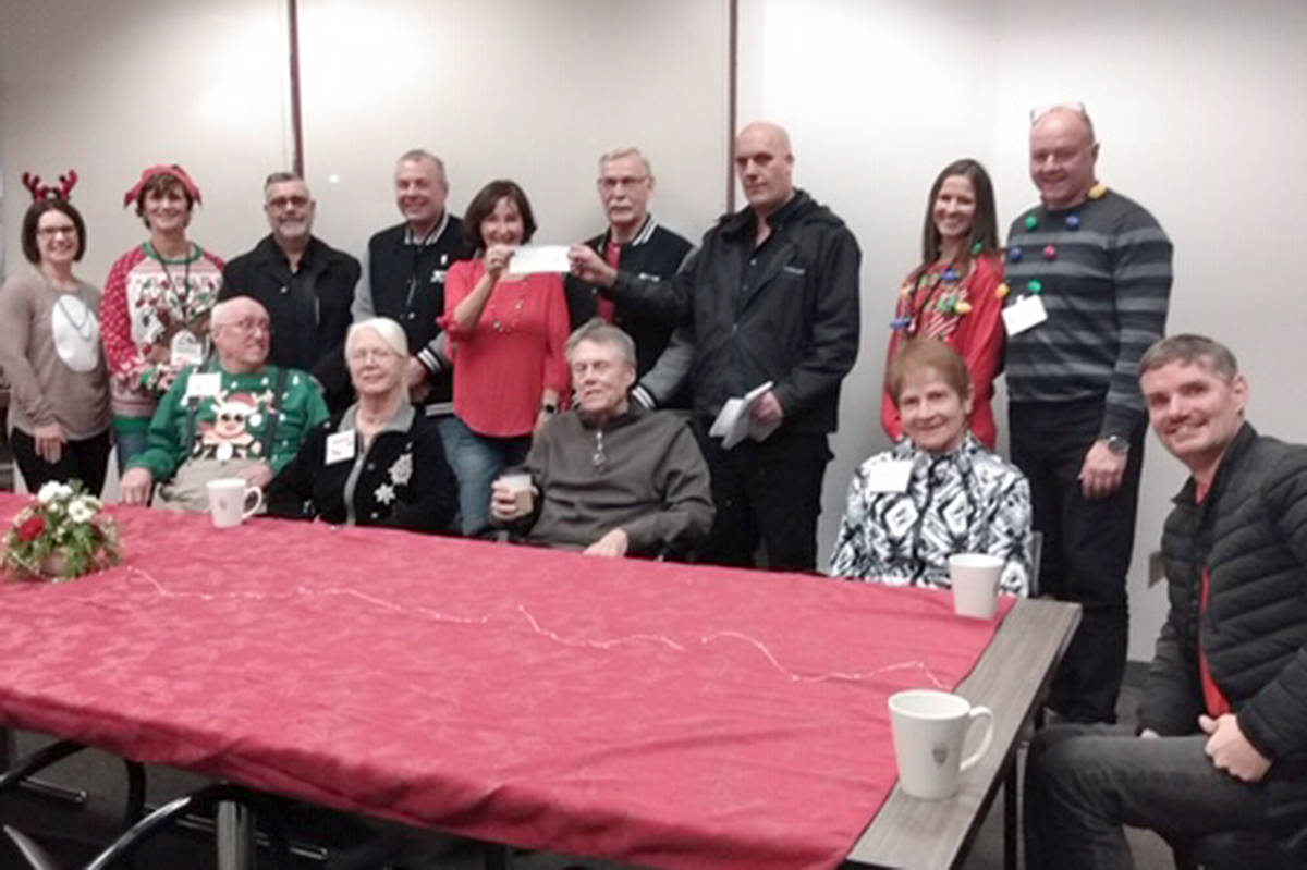 Cruise-In volunteers and directors turned up for the Hope After Stroke support group's annual holiday party, bringing with them an early Christmas gift – $10,000. (Special to the Langley Advance Times)