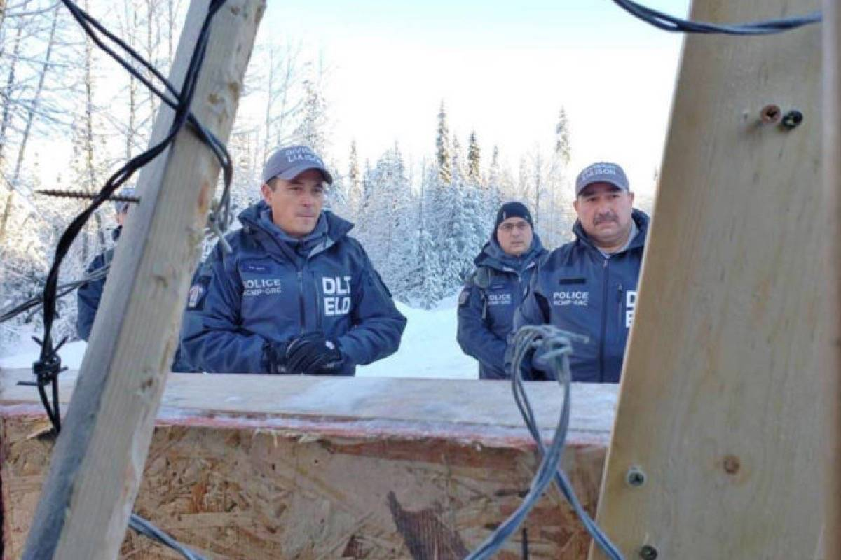 Officers pictured at the Gidimt'en checkpoint on Jan. 7, 2019. Skeena-Bulkley Valley MP Taylor Bachrach is calling for an independent review of police action following the RCMP's dismantling of the Gidimt'en checkpoint on Jan. 7, 2019. (Canadian Press photo)