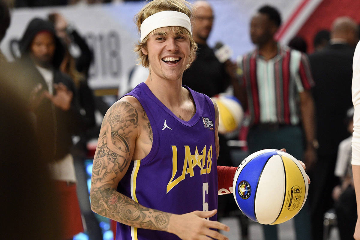 Justin Bieber has delivered an early Christmas gift to his fans, revealing details on an upcoming album and North American tour. Singer Justin Bieber warms up prior to the NBA All-Star celebrity basketball game in Los Angeles, Friday, Feb. 16, 2018. THE CANADIAN PRESS/AP-Chris Pizzello