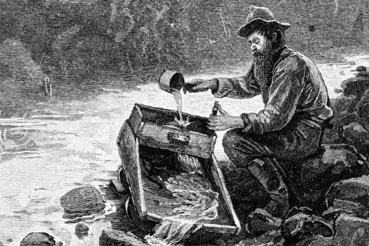 A gold seeker uses a rocker box for placer mining in the 19th Century, the activity that sparked European settlement of British Columbia during a series of gold rushes. (Wikimedia Commons)