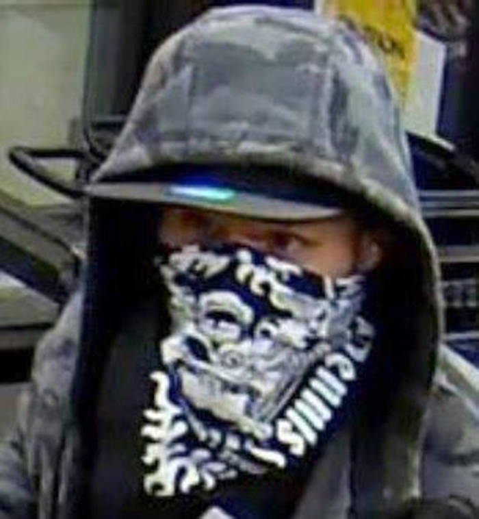 A still photo captured from surveillance video shows the suspect in two armed robberies Monday night in Abbotsford.