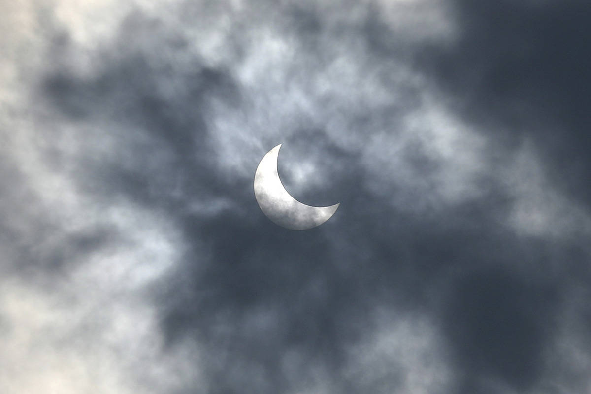 A partial solar eclipse is seen from Jakarta, Indonesia Thursday, Dec. 26, 2019. (AP Photo/Tatan Syuflana)
