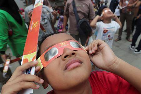 PHOTOS: Thousands in Asia marvel at 'ring of fire' solar eclipse