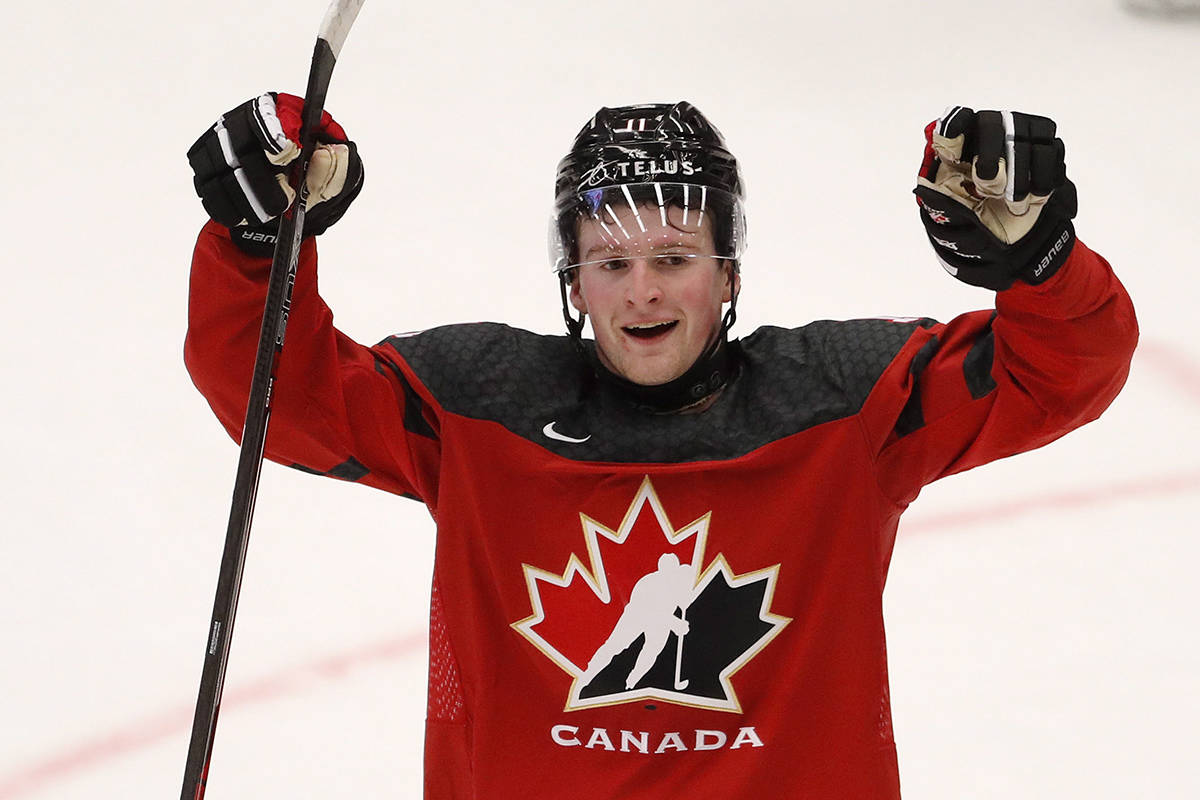 Canada's Alexis Lafreniere celebrates his sides first goal during the U20 Ice Hockey Worlds match between Canada and the United States in Ostrava, Czech Republic, Thursday, Dec. 26, 2019. (AP Photo/Petr David Josek)