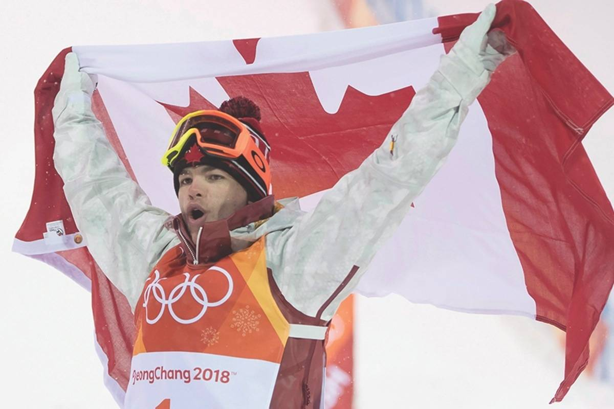 Canadian Mikael Kingsbury celebrates winning his gold medal at the moguls finals at the Phoenix Snow Park at the Pyeongchang 2018 Winter Olympic Games in South Korea, Monday, Feb. 12, 2018. THE CANADIAN PRESS/Jonathan Hayward
