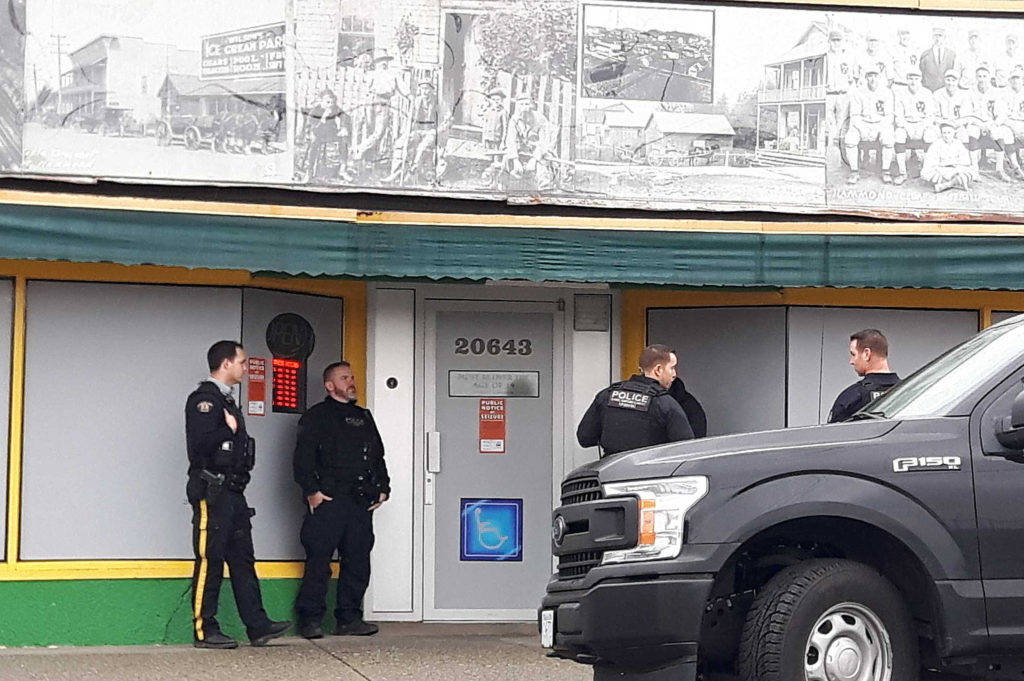 Police officers with the Community Safety Unit closed Hammond Compassion Society store, Dec. 18, in Maple Ridge. (THE NEWS/files)