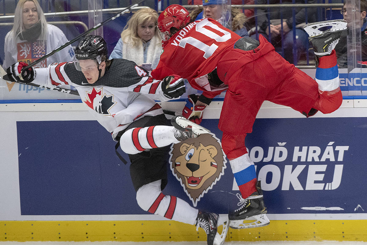 Canada's Bowen Byram (left) is checked by Russia's Dmitri Voronkov during first period action at the World Junior Hockey Championship, Saturday, Dec. 28, 2019 in Ostrava, Czech Republic. THE CANADIAN PRESS/Ryan Remiorz