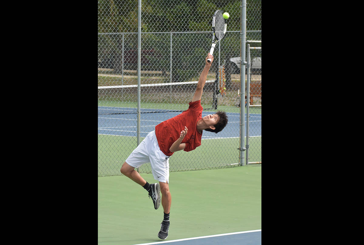 """'For the reach' by Cameron Thomson with the Salmon Arm Observer. """"The shape and symmetry of the tennis player's body always reminds me of a Greek statue. I was ecstatic when I looked through the photos taken at this event and saw this one, it was exactly the shot I wanted to get; a sharp image at the very peak of his serve."""""""