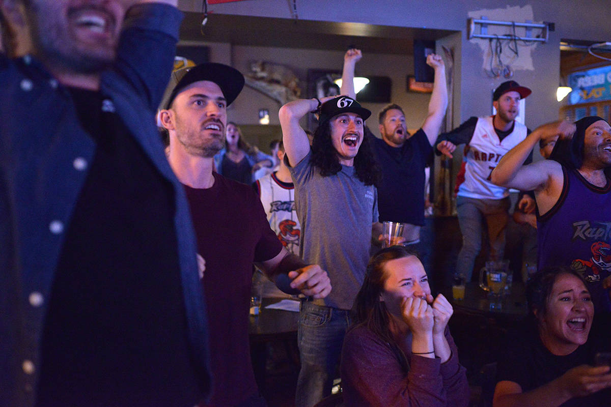 """'Toronto Raptors are NBA Champs' by Phil McLachlan for the Fernie Free Press. """"An entire country united; on June 13 the Toronto Raptors were named the NBA champions. In a small bar in Fernie, the emotion brought the roof down. Pictured above is the moment before the Raptors won. It served as a momentous night not soon to be forgotten."""""""