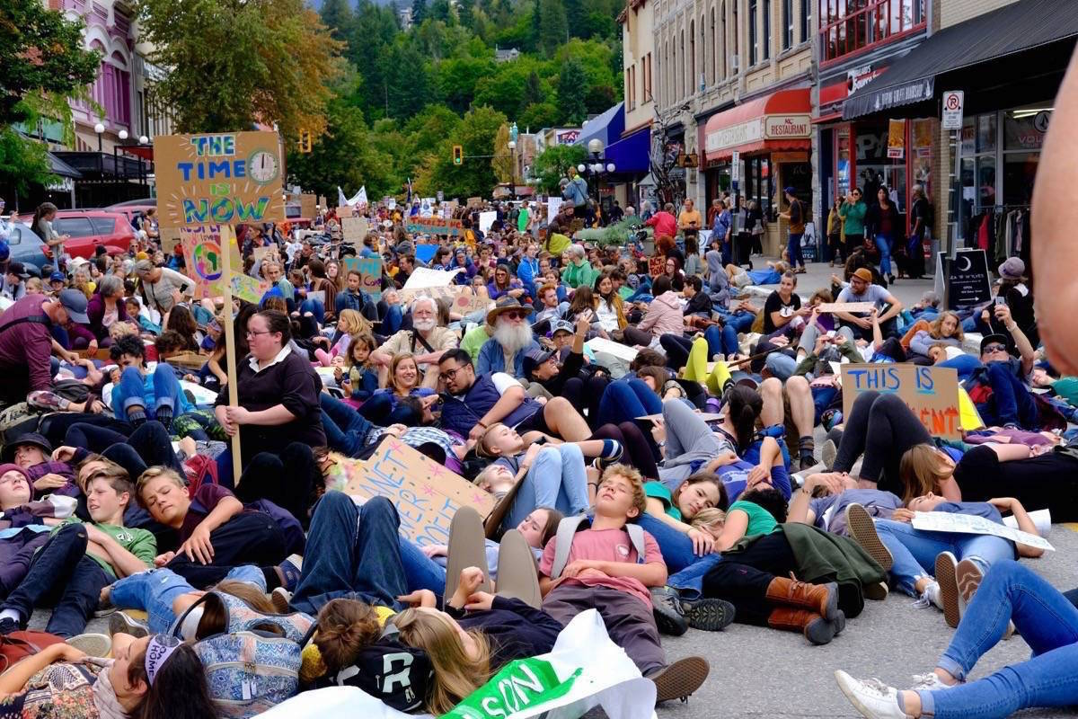 """'Youth climate strike 'die-in' by 1,000 people in Nelson' by Bill Metcalfe with the Nelson Star. """"I like it because it's not every day you see 1,000 lying down in the street."""""""