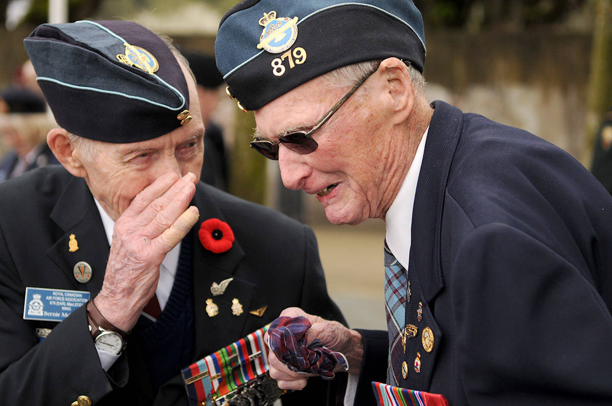 """'Commemorating Vimy Ridge' by Jenna Hauck with the Chilliwack Progress. """"Bernie McNicholl (left), 93, gets a chuckle out of 94-year-old Werner Hockin following the 102nd commemoration of the battle of Vimy Ridge at All Sappers' Memorial Park on Tuesday. The two veterans both fought in the Second World War."""""""