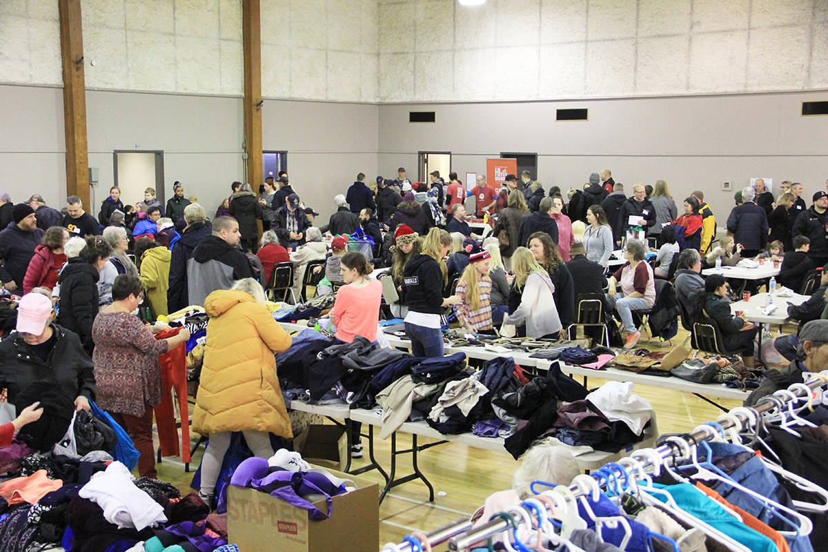 Families shop for free second-hand clothes and toys Dec. 21 during the Cloverdale Christmas Hamper Program's distribution day. (Photo: Malin Jordan)