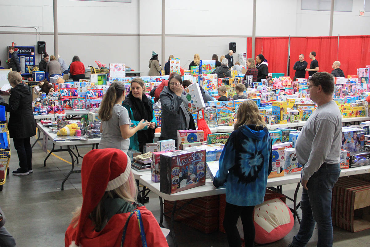 Families shop for free new toys Dec. 21 during the Cloverdale Christmas Hamper Program's distribution day. (Photo: Malin Jordan)