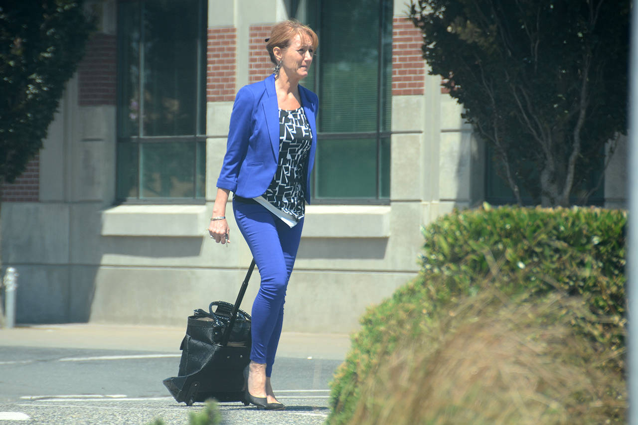 Debbie Anderson outside the Chilliwack Law Courts after her trial wrapped up July 6, 2017. Anderson was convicted with evading taxes and fraud for teaching others that paying income taxes is optional. She was sentenced to 4.5 years jail, a sentenced she is now serving after being arrested Dec. 19, 2019. (Paul Henderson/ The Progress)
