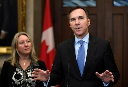 Minister of Finance Bill Morneau and Minister of Middle Class Prosperity and Associate Minister of Finance Mona Fortier make an announcement on lowering taxes for the middle class in the Foyer of the House of Commons on Parliament Hill in Ottawa, on Monday, Dec. 9, 2019. (THE CANADIAN PRESS/Justin Tang)