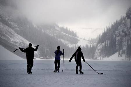 Hockey players make the most of the fading daylight as they skate on Lake Louise, Alta., Wednesday, Dec. 4, 2019. THE CANADIAN PRESS/Frank Gunn