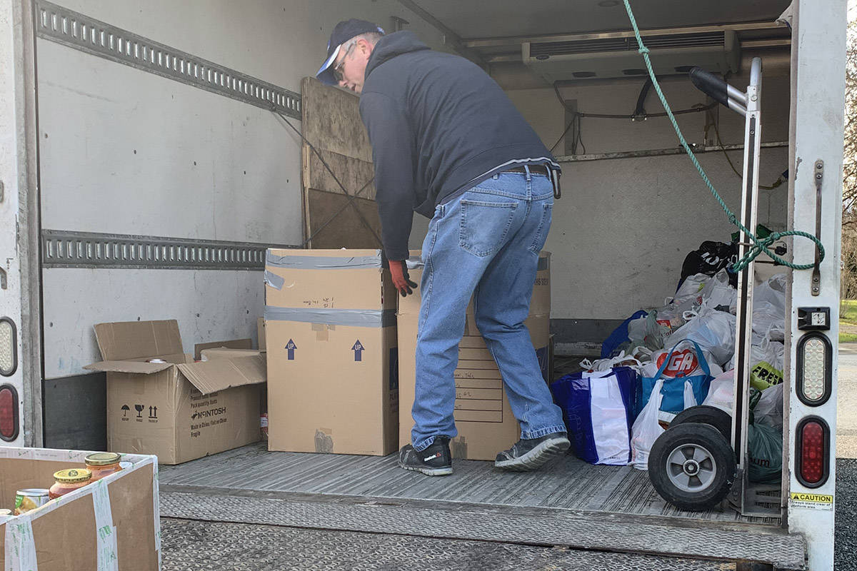 A truck from the Salvation Army came on Christmas Eve to pick up the 5,000-plus non-perishable food items that were collected in three days from Katharine and Johnathan Wall's Harry Potter-themed Christmas house. (Submitted)