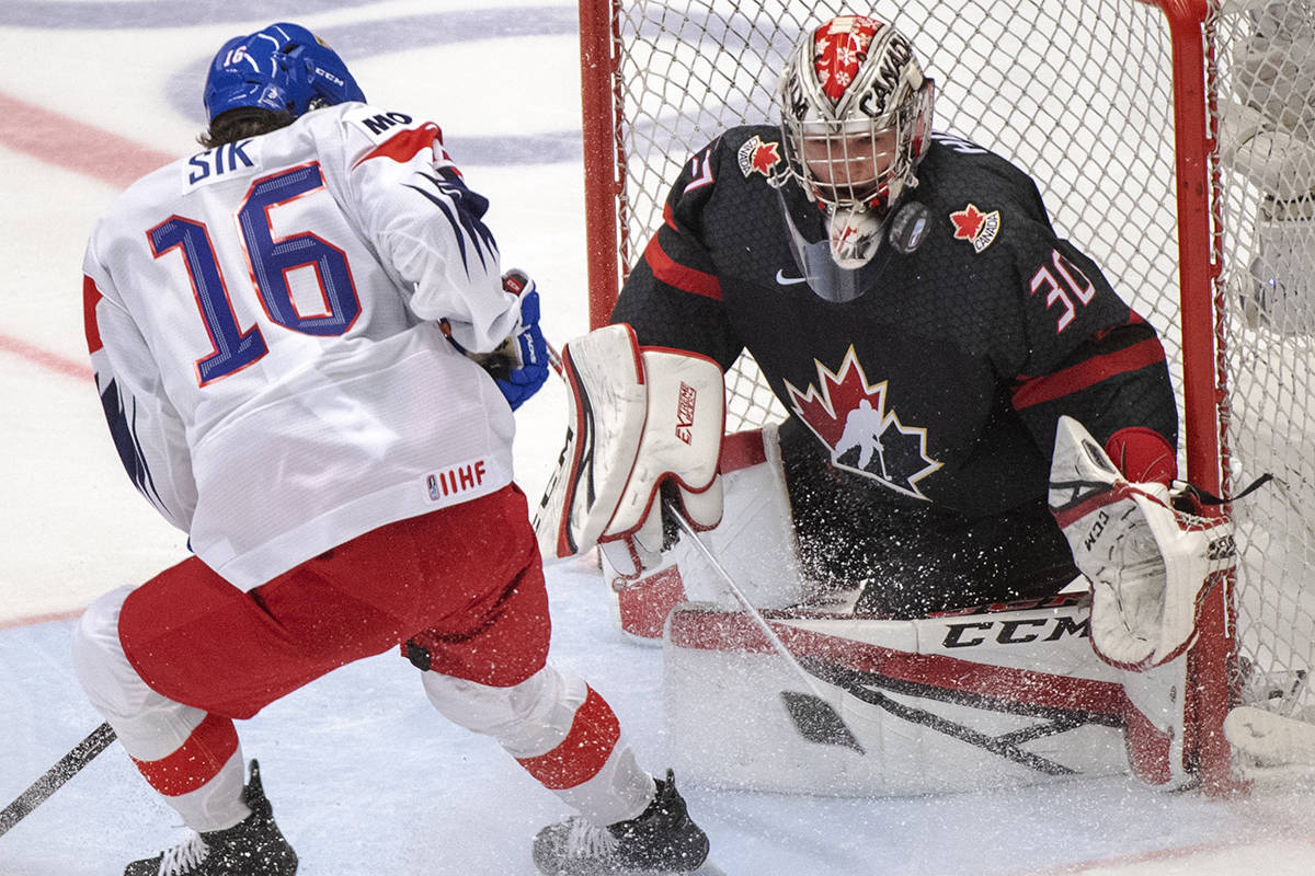 Canada's goaltender Joel Hofer makes the save on Czech Republic's Otakar Sik during first period action at the World Junior Hockey Championships on Tuesday, December 31, 2019 in Ostrava, Czech Republic. THE CANADIAN PRESS/Ryan Remiorz