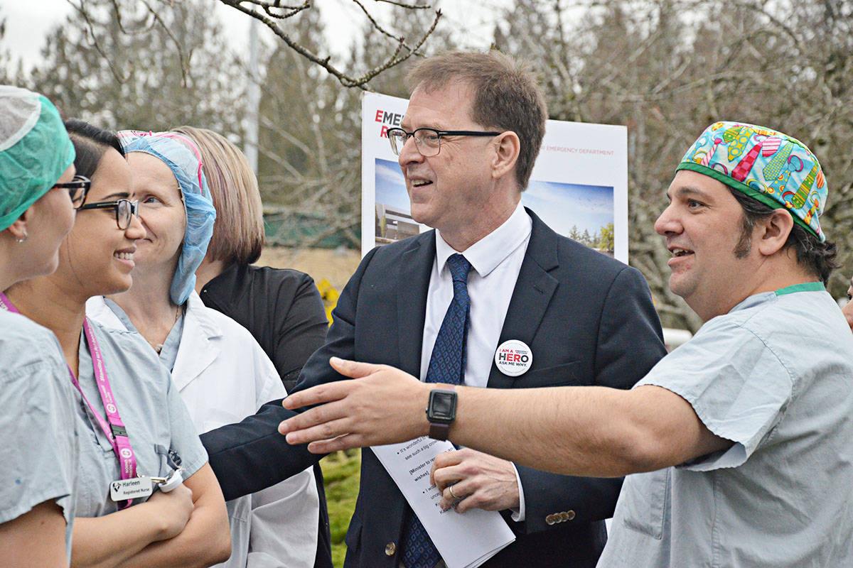 Health minister Adrian Dix, centre, with Dr. Mitra Maharaj, right, and other doctors and nurses at the official start of construction in January, 2019 for the Langley Memorial Hospital ER expansion. (Langley Advance Times files)
