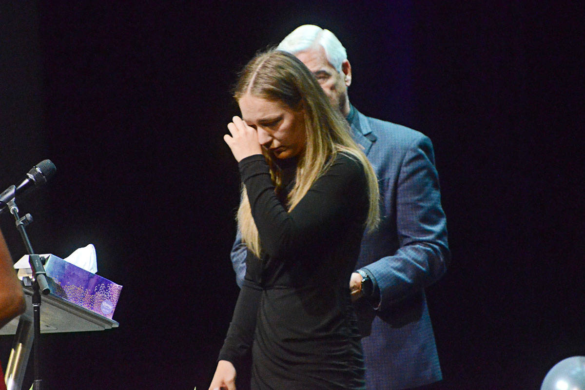Carson Crimeni's sister Bella Griffiths wiped away tears after speaking at Carson's celebration of life on Thursday. (Ryan Uytdewilligen/Langley Advance Times)