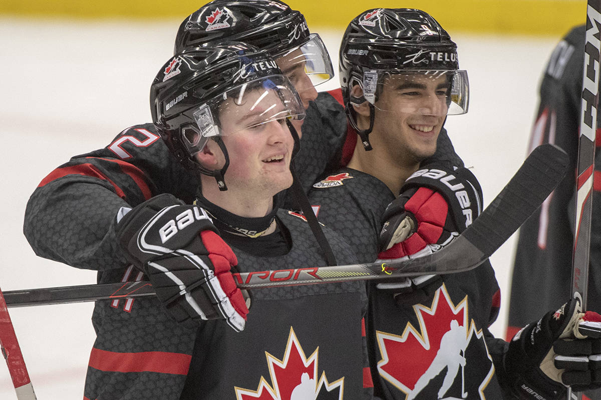 Canada's Alexis Lafreniere, left, Dylan Cozens, centre, and Joe Veleno, right, celebrate after defeating Slovakia 6-1 at the World Junior Hockey Championships on Thursday, January 2, 2020 in Ostrava, Czech Republic. THE CANADIAN PRESS/Ryan Remiorz