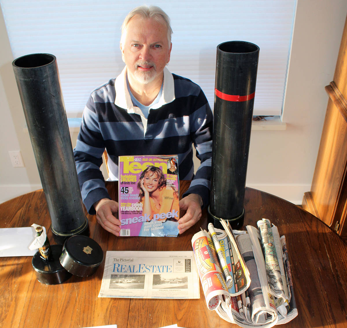 Dan Robin with a magazine cover featuring a very young Britney Spears, the cover of the Pictorial real estate section and other newspapers from the end of the 1990s. (Photo by Don Bodger)