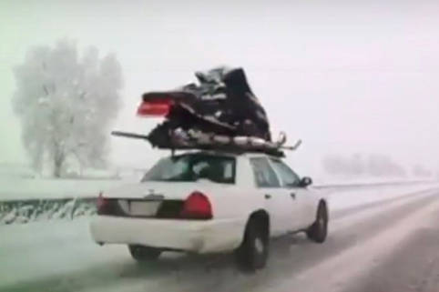 Snowmobile strapped to roof of sedan spotted in Kamloops