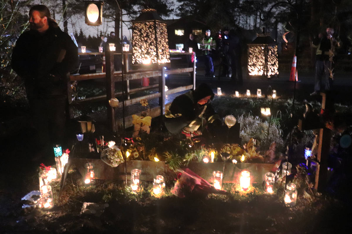 Mourners from Aldergrove gathered Monday at a roadside memorial on 36th Avenue to honour a young life that was ended abruptly 17 years ago to the day. (Sarah Grochowski photo)