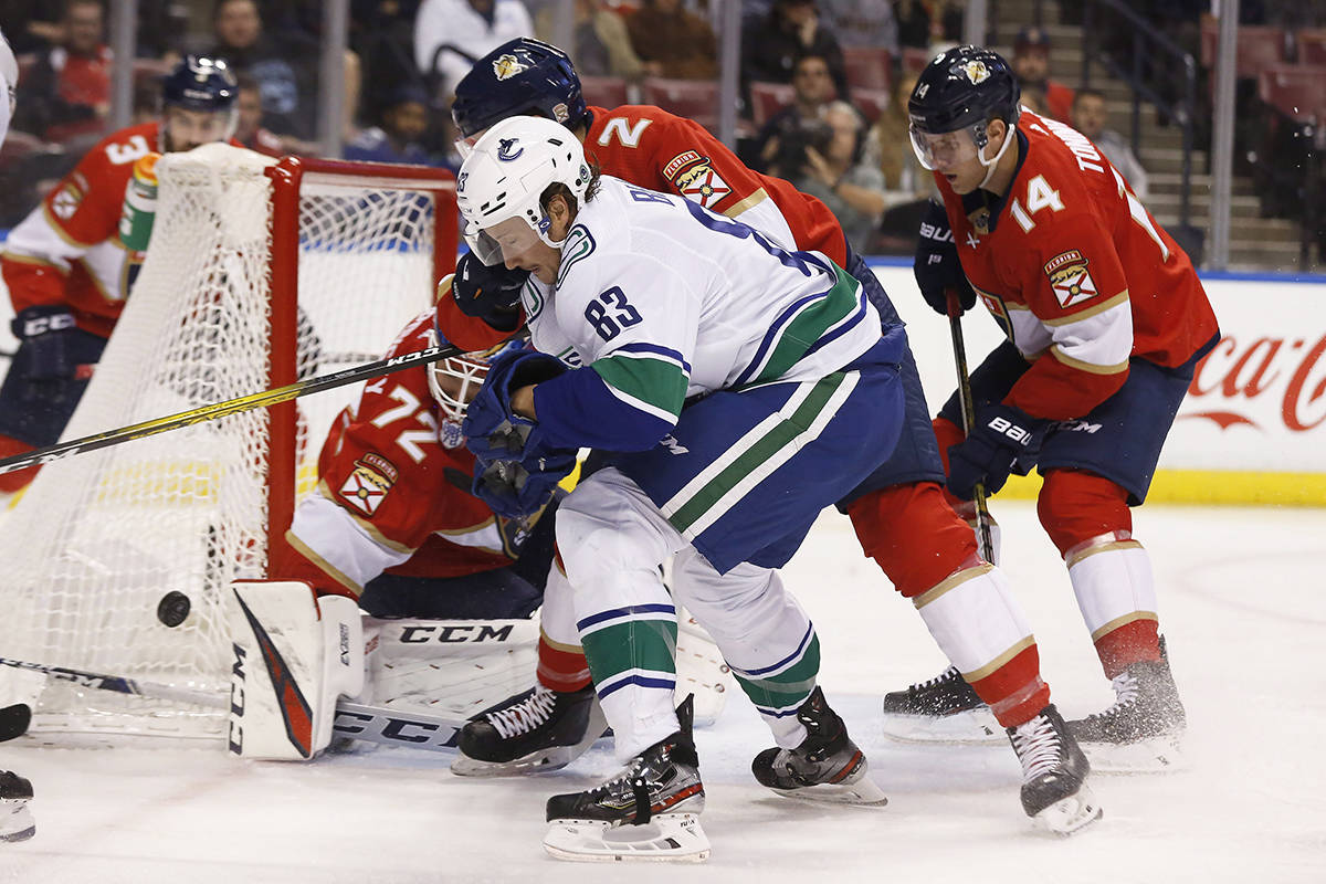 Vancouver Canucks centre Jay Beagle (83) fights to score during an NHL hockey game against the Florida Panthers, Thursday, Jan. 9, 2020, in Sunrise, Fla. (AP Photo/Brynn Anderson)
