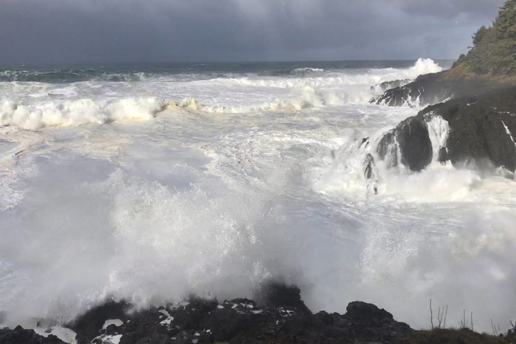 In this Saturday, Jan. 11, 2020, photo strong waves crash on the seashore near Otter Rock in Lincoln County, Ore. A 7-year-old girl is dead and her 4-year-old brother is missing after they and their father were swept into the ocean Saturday, on the Oregon coast amid a high-surf warning. Oregon State Police say 47-year-old Jeremy Stiles of Portland and the girl were taken to Providence Seaside Hospital, while the Coast Guard deployed helicopters to help search for the boy. The girl was pronounced dead at the hospital. (AP Photo/Gillian Flaccus)