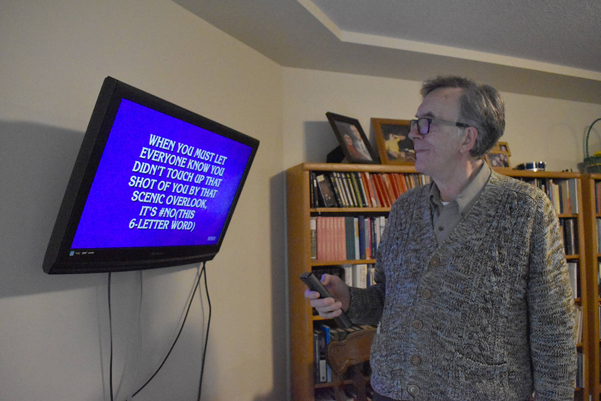 A stroke left Joel Rosenau with the inability to read. He is relearning the skill, with the aid of the popular television game show, Jeopardy! Photo by Terry Farrell