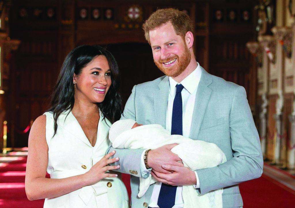 FILE - In this Wednesday May 8, 2019 file photo, Britain's Prince Harry and Meghan, Duchess of Sussex, during a photocall with their newborn son, in St George's Hall at Windsor Castle, England. A local mayor says Prince Harry and Meghan Markle chose the perfect place to rest and relax over the holiday season before announcing their decision to step back as senior members of the Royal Family. THE CANADIAN PRESS/Dominic Lipinski/Pool via AP, file)