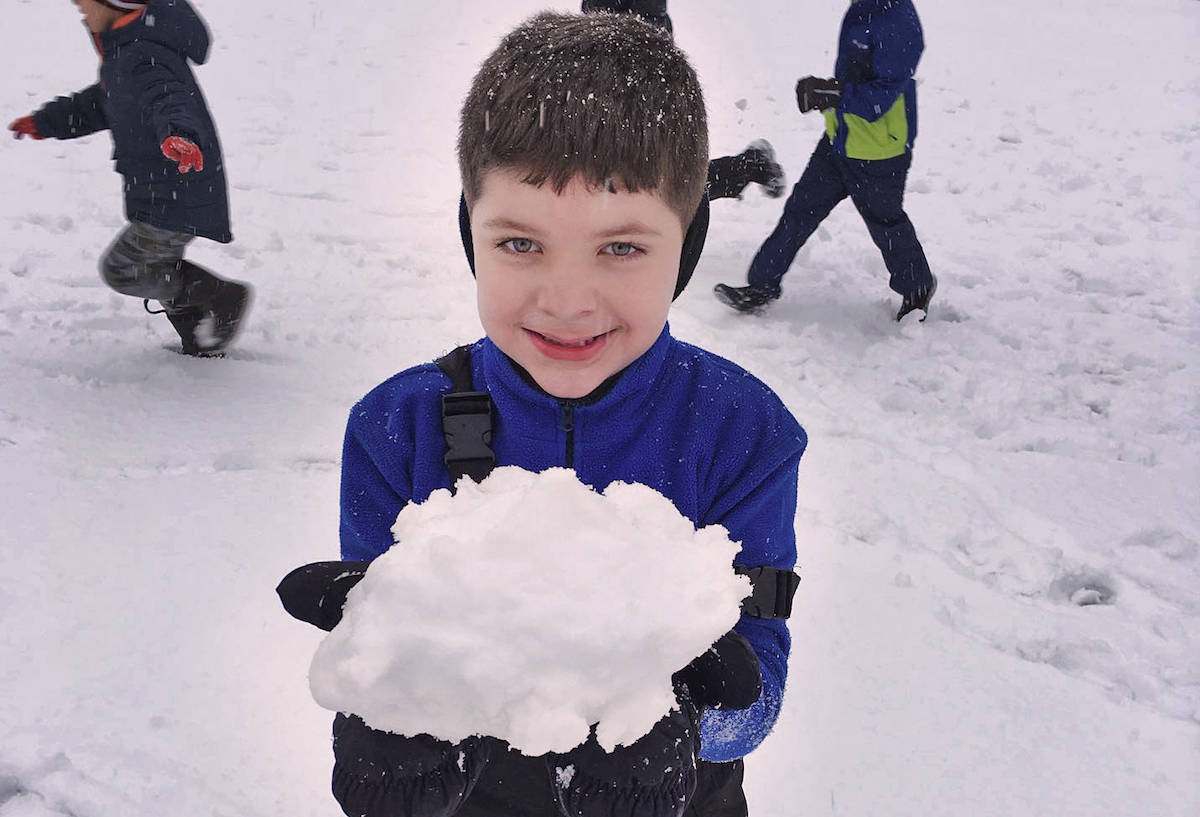 Shortreed Elementary's Grade 1 student Nathan Guilherme enjoyed a day at school, both inside and outside in knee-deep snow with classmates this week. (Submitted photo)