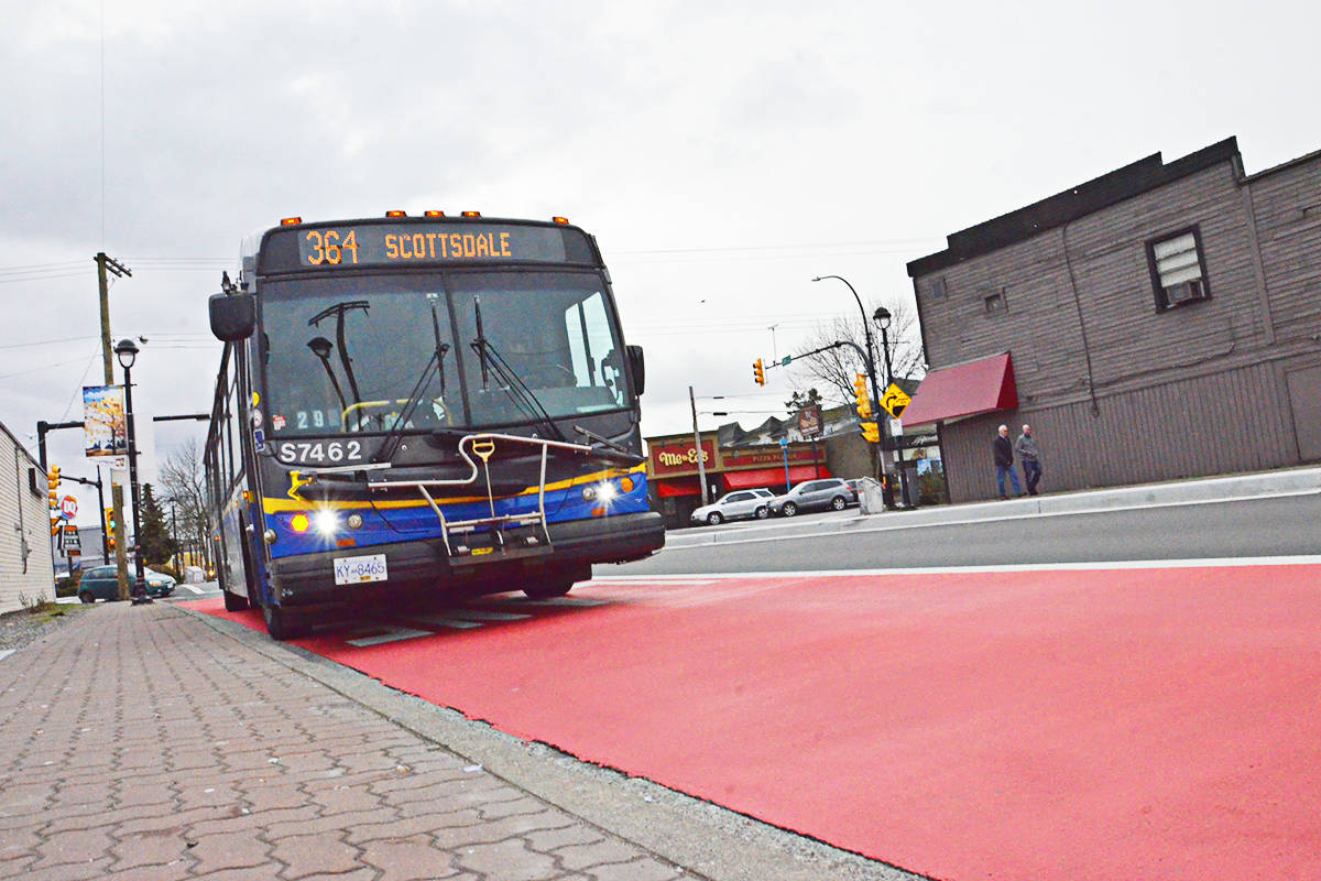 Bus lanes, marked out in red where they begin and end, have changed the way drivers can get around downtown Langley City on Fraser Highway, Logan Avenue, and 203rd Street. (Heather Colpitts/Langley Advance Times)