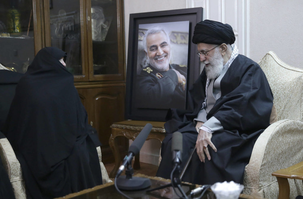 """In this picture released by the official website of the office of the Iranian supreme leader, Supreme Leader Ayatollah Ali Khamenei, right, meets family of Iranian Revolutionary Guard Gen. Qassem Soleimani, who was killed in the U.S. airstrike in Iraq, at his home in Tehran, Iran, Friday, Jan. 3, 2020. Iran has vowed """"harsh retaliation"""" for the U.S. airstrike near Baghdad's airport that killed Tehran's top general and the architect of its interventions across the Middle East. (Office of the Iranian Supreme Leader via AP)"""