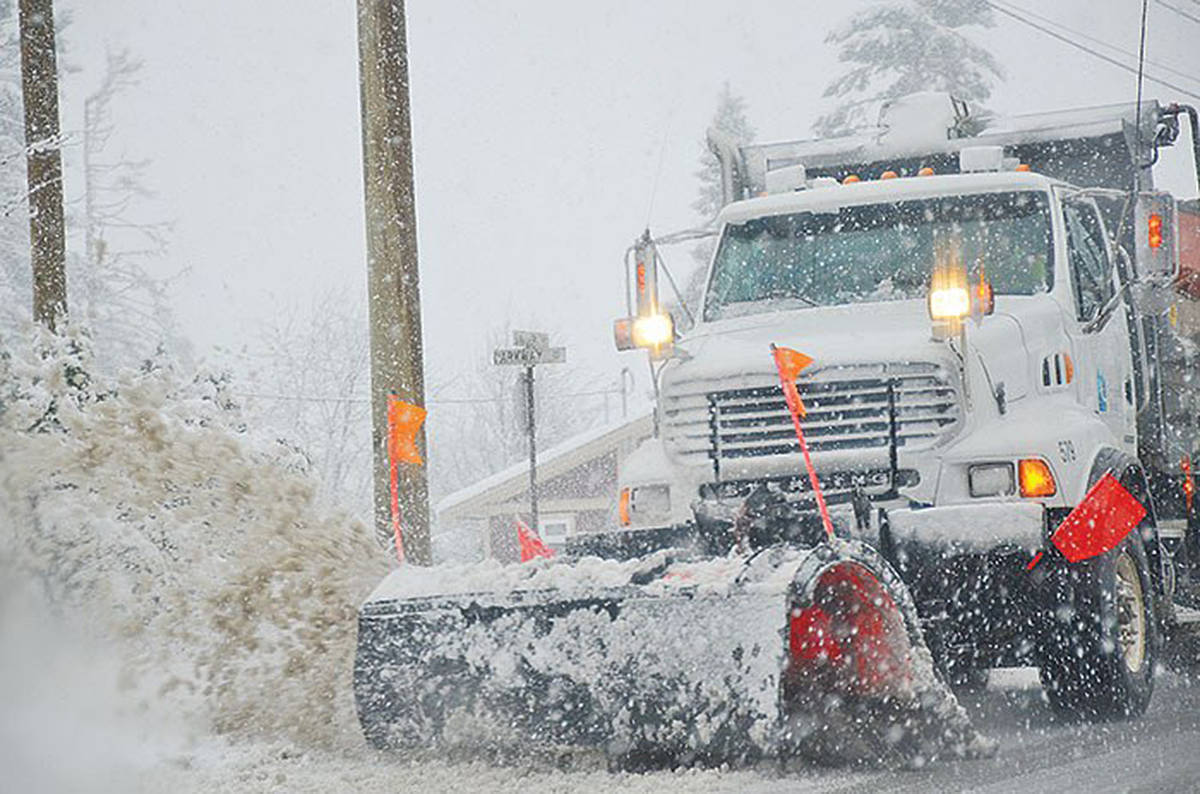 Snow plow clearing roads in Langley. (Langley Advance Times files)