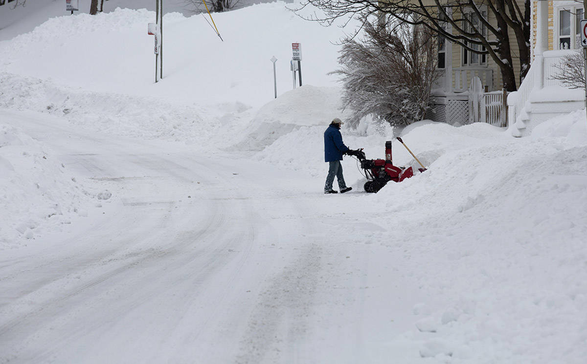 A man clears his driveway on Craigmillar Ave. in St. John's on Monday, January 6, 2020, following the first major snowstorm of the year. THE CANADIAN PRESS/Paul Daly