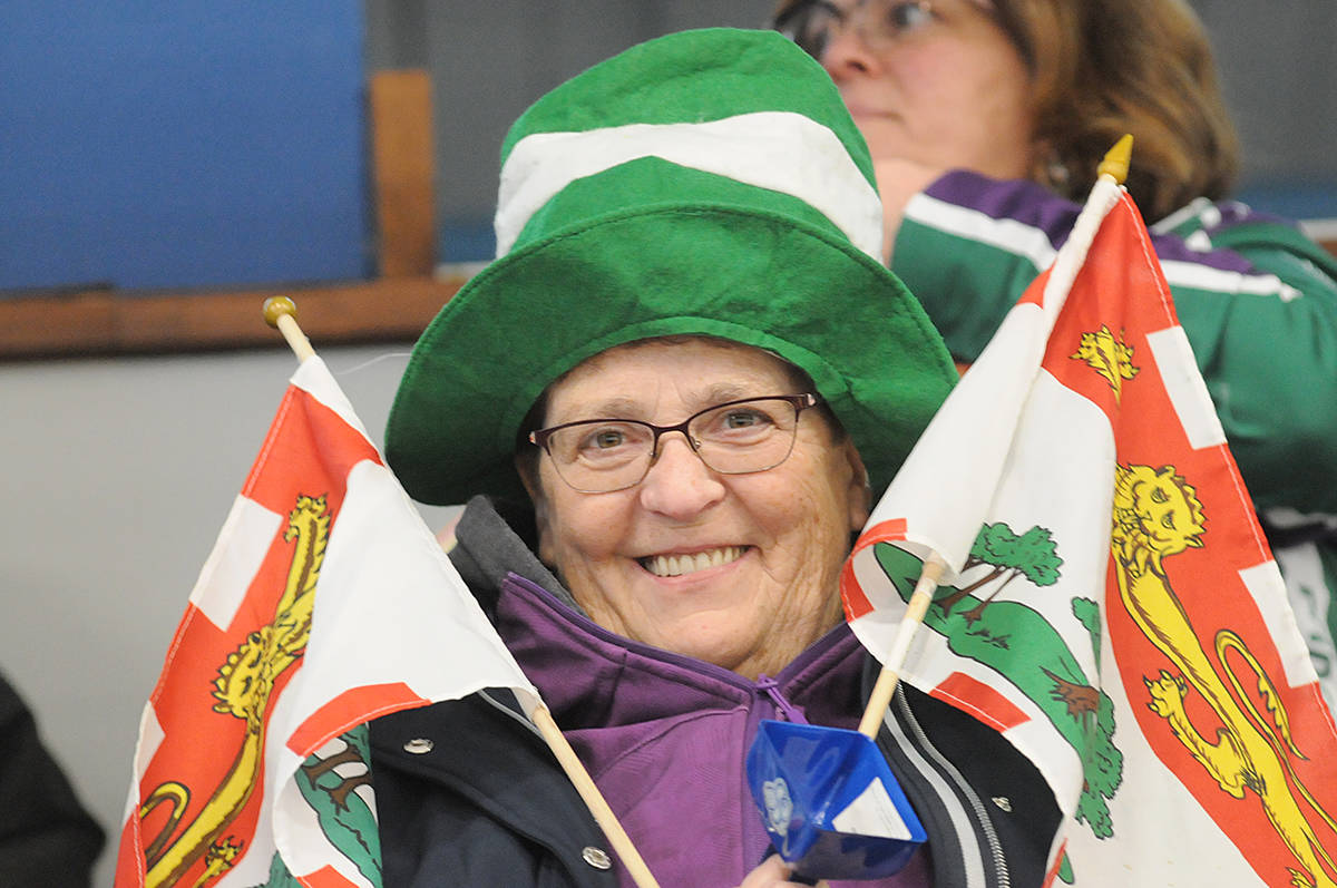 A flag-waving fan was there to root for her team at the opening ceremonies of the 2020 New Holland Canadian Junior Championships of curling at the George Preston rec centre on Saturday. (Dan Ferguson/Langley Advance Times)