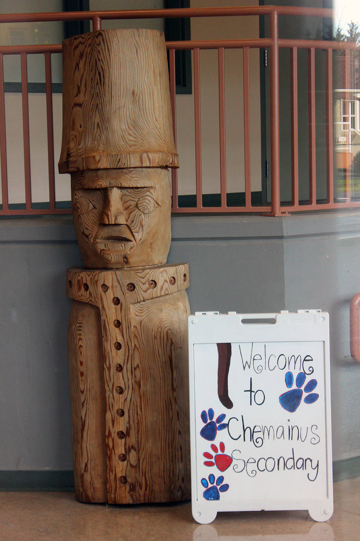 Totem pole inside Chemainus Secondary School at the entrance was carved by Gus Modeste. (Photo by Don Bodger)