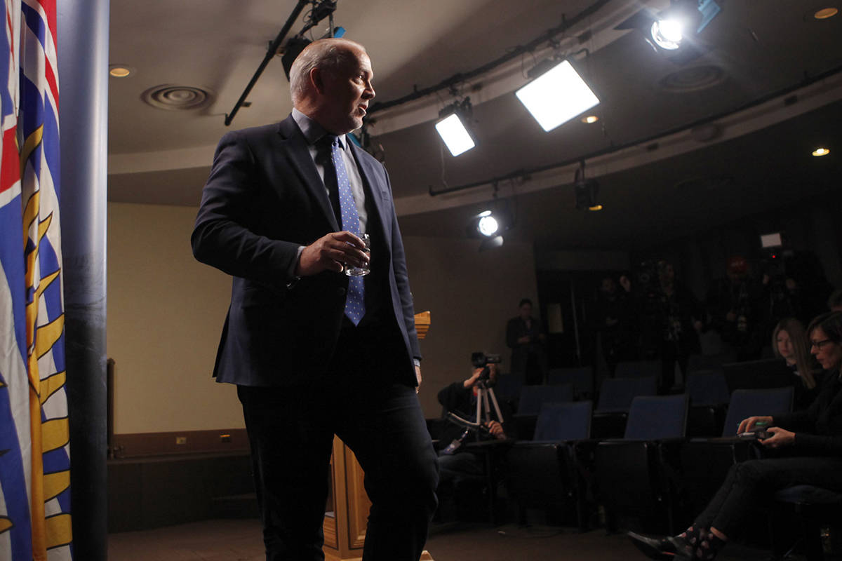 Premier John Horgan leaves the podium following his first press conference of the year as he comments on various questions from the media in the Press Gallery at B.C. Legislature in Victoria, B.C., on Monday, January 13, 2020. THE CANADIAN PRESS/Chad Hipolito