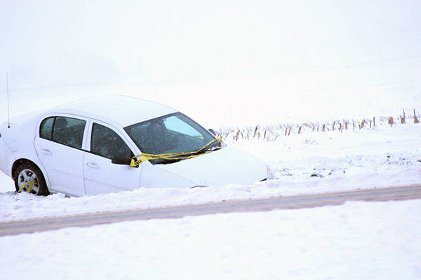 A ditched car off Highway 1. Tyler Olsen / Abbotsford News.