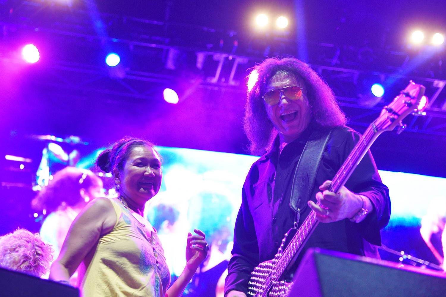 Gene Simmons dances with guests onstage at CannaFest 2018.                                (Kathleen Saylors/Grand Forks Gazette)