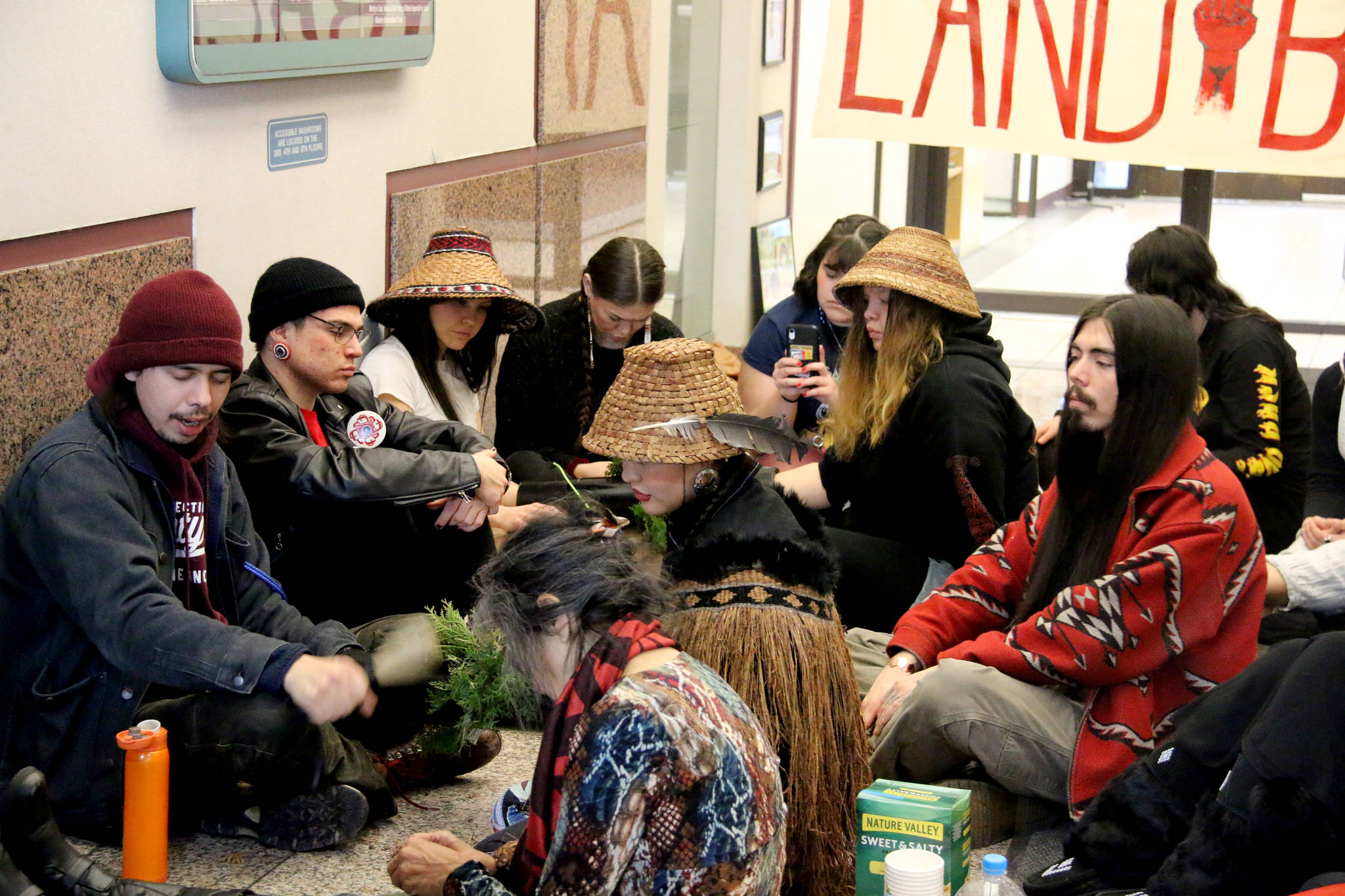Kolin Sutherland-Wilson sings a traditional Wet'suwet'en song at the protest on Tuesday. (Kendra Crighton/News Staff)