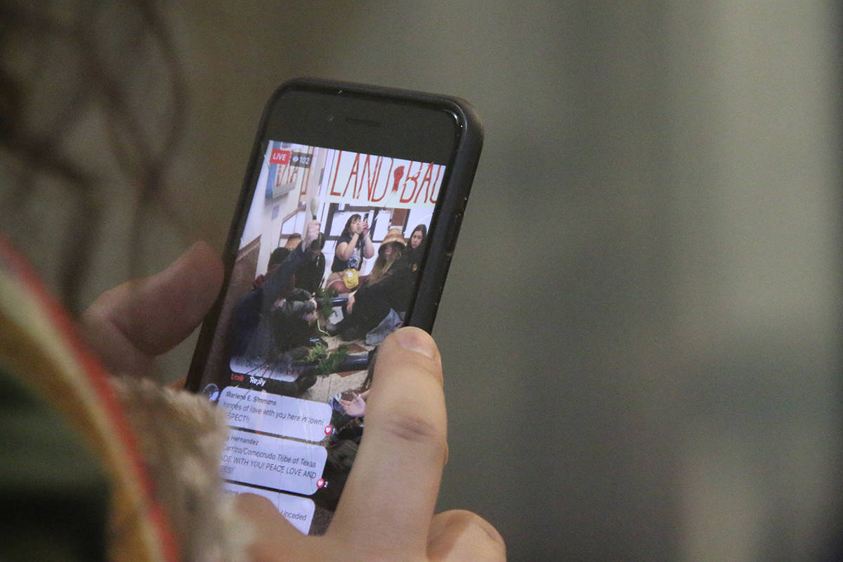 A video of the protest was live-streamed to the Indigenous Climate Action facebook page. (Kendra Crighton/News Staff)