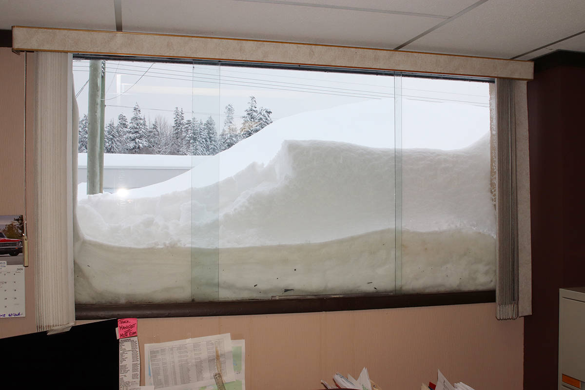 Heavy snowfall cracked a window at the Kitimat Northern Sentinel on Sunday, Jan. 19, 2020, unleashing an avalanche 12 feet into the newsroom. (Gerry Leibel/Northern Sentinel)