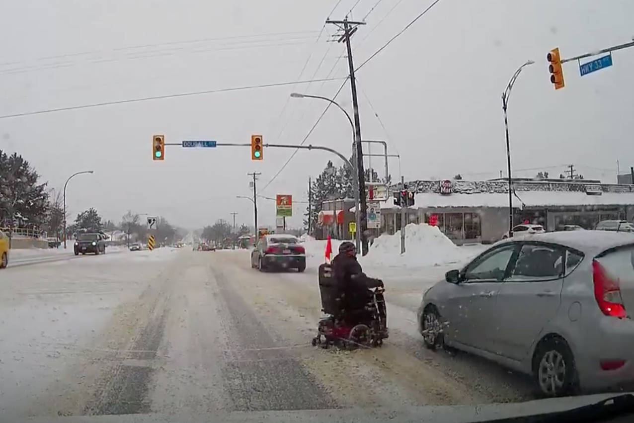 VIDEO: Person in wheelchair narrowly avoids collision with car in Kelowna