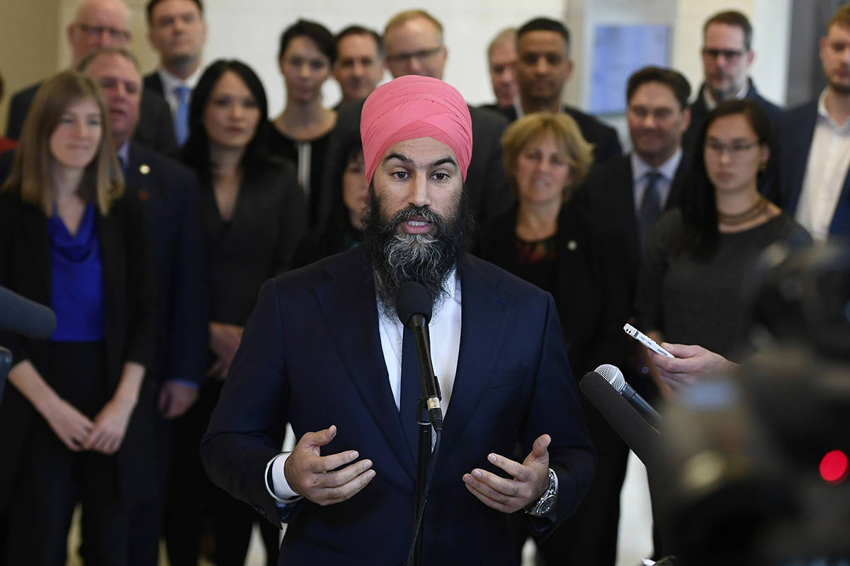 NDP Leader Jagmeet Singh stands in front of his caucus as he speaks to reporters after the weekly caucus meeting in Ottawa on Wednesday, Dec. 4, 2019. New Democrat MPs will gather in Ottawa today for a two-day planning session to prepare the re-opening of the House of Commons next week. THE CANADIAN PRESS/Justin Tang
