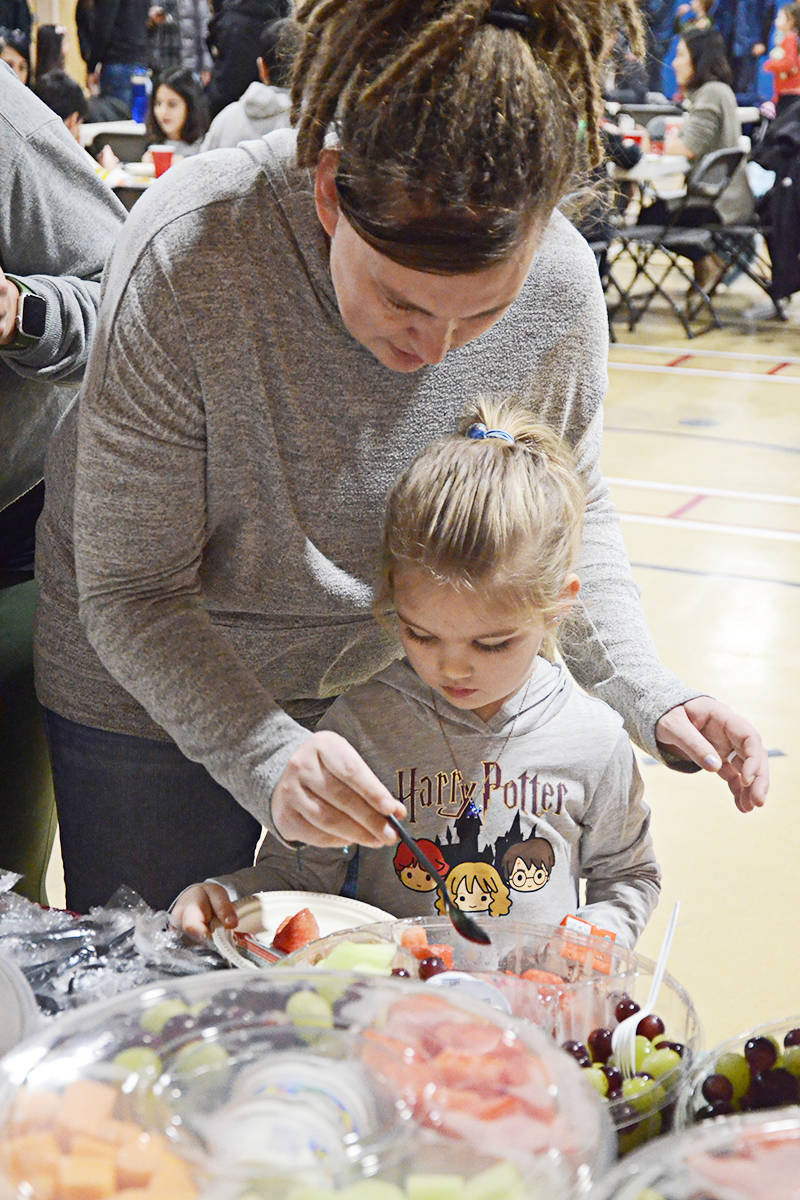 Renée Rathjen and her daughter Ivy, four, at the Willoughby Elementary breakfast Friday. (Matthew Claxton/Langley Advance Times)