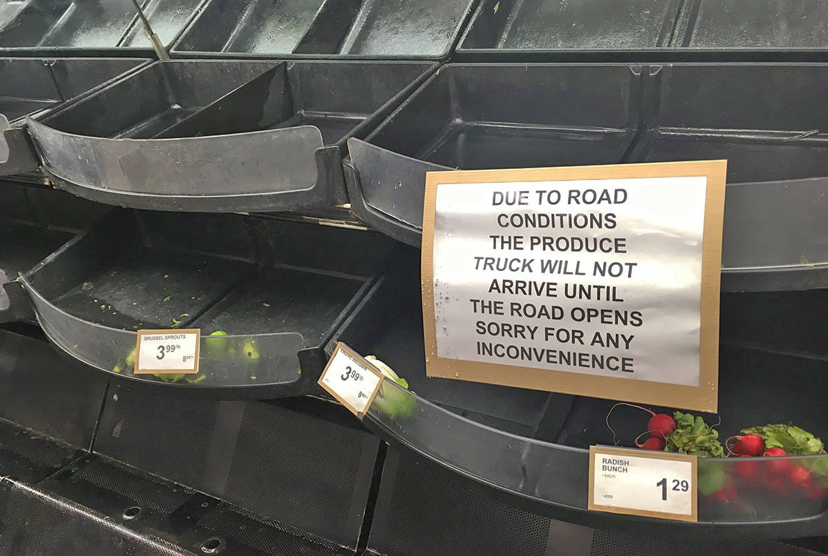 The Ucluelet Co-op's fresh produce aisle is nearly bare and a note has been posted informing customers that the shelves will not be restocked until Hwy. 4 reopens. (Andrew Bailey photo)